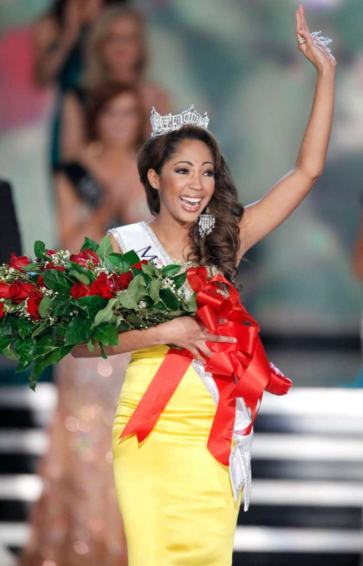 Miss Virginia Caressa Cameron reacts after being crowned Miss America Saturday Jan. 30, 2010 in Las Vegas. (AP Photo/Eric Jamison)
