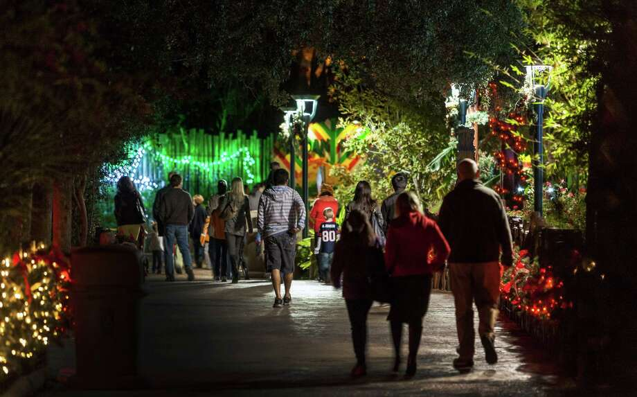 The Houston Zoo, 6200 Hermann Park Drive. Early tour of spectacular Zoo Lights allows its biggest donors a sneak peek of the holiday festival. It opens to the public 6 p.m.-10 p.m., Nov. 23-Jan. 5.  ID: exploring the lights  Friday 11/16/12 (Craig H. Hartley/For the Chronicle) Photo: Craig Hartley, Freelance / Copyright: Craig H. Hartley