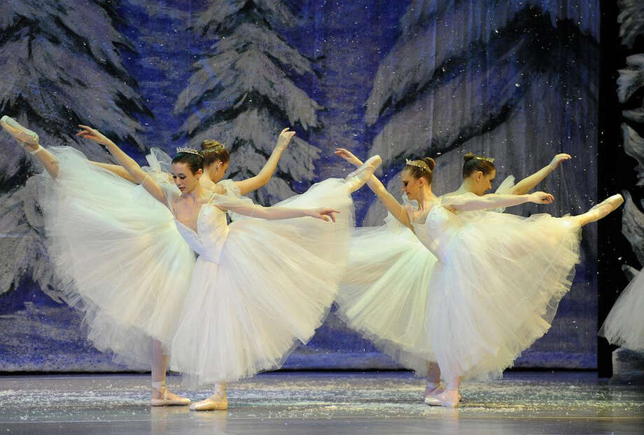 "Houston Repertoire Ballet members portray snow flakes in ""The Nutcracker."""