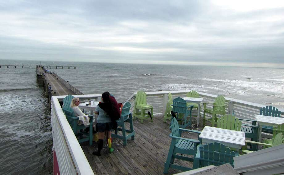 Jimmy's on the Pier on Galveston Island is a casual spot with colorful Adirondack seating that offers dreamy views of the Gulf. Photo: Syd Kearney