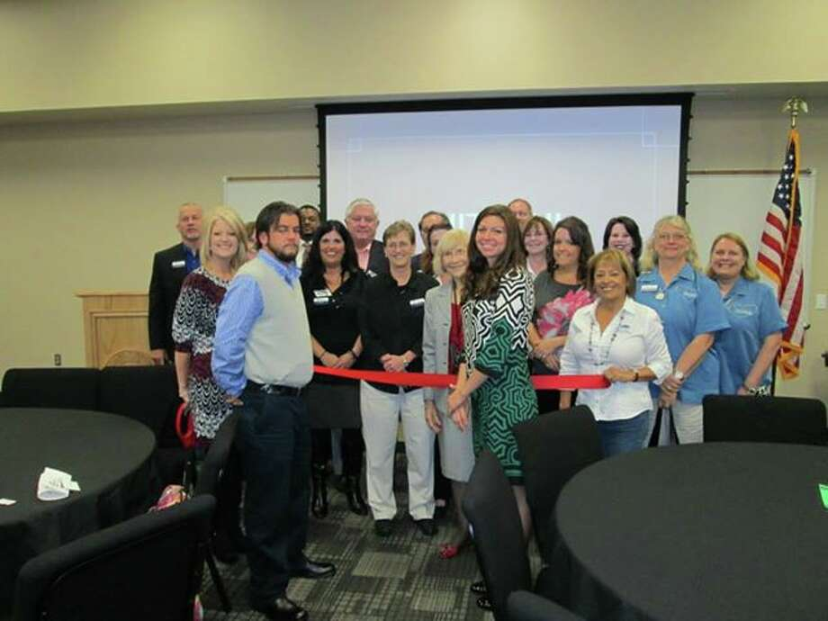 Stacks Heating and Air Conditioning personnel celebrate a ribbon cutting Nov. 5. Photo: Provided By Spring-Klein Chamber Of Commerce