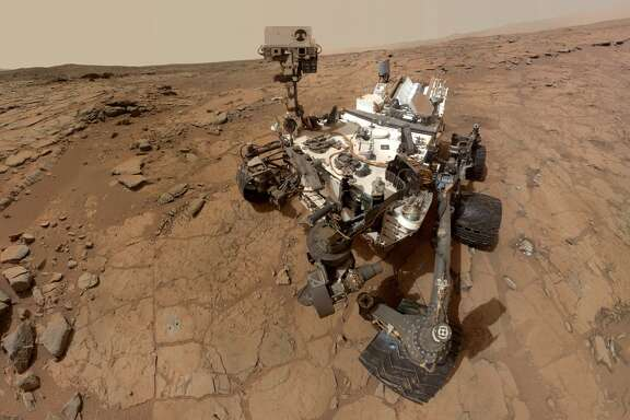 NASA's Curiosity rover takes a self-portrait in Gale Crater on Mars. Measurements of the Martian air found it is mostly made of carbon dioxide with traces of other gases. (NASA/AP Photo)