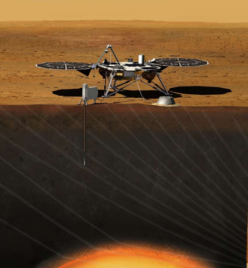 This image provided by NASA shows an artist rendition of the proposed InSight (Interior exploration using Seismic Investigations, Geodesy and Heat Transport) Lander. After driving all around Mars with four rovers, NASA wants to look deep into the guts of the red planet. The space agency decided on Aug. 20, 2012, to launch a relatively low-cost robotic lander in 2016 to check out what makes the Martian core so different from Earth's. (AP Photo/NASA) Photo: Associated Press