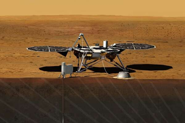 This image provided by NASA shows an artist rendition of the proposed InSight (Interior exploration using Seismic Investigations, Geodesy and Heat Transport) Lander. After driving all around Mars with four rovers, NASA wants to look deep into the guts of the red planet. The space agency decided on Aug. 20, 2012, to launch a relatively low-cost robotic lander in 2016 to check out what makes the Martian core so different from Earth's. (AP Photo/NASA)