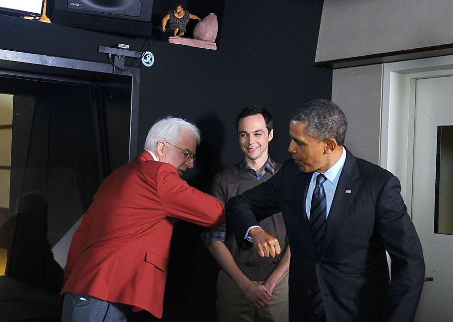 President Obama greets actor Steve Martin as actor Jim Parsons looks on at DreamWorks Animation. Photo: Jewel Samad, AFP/Getty Images
