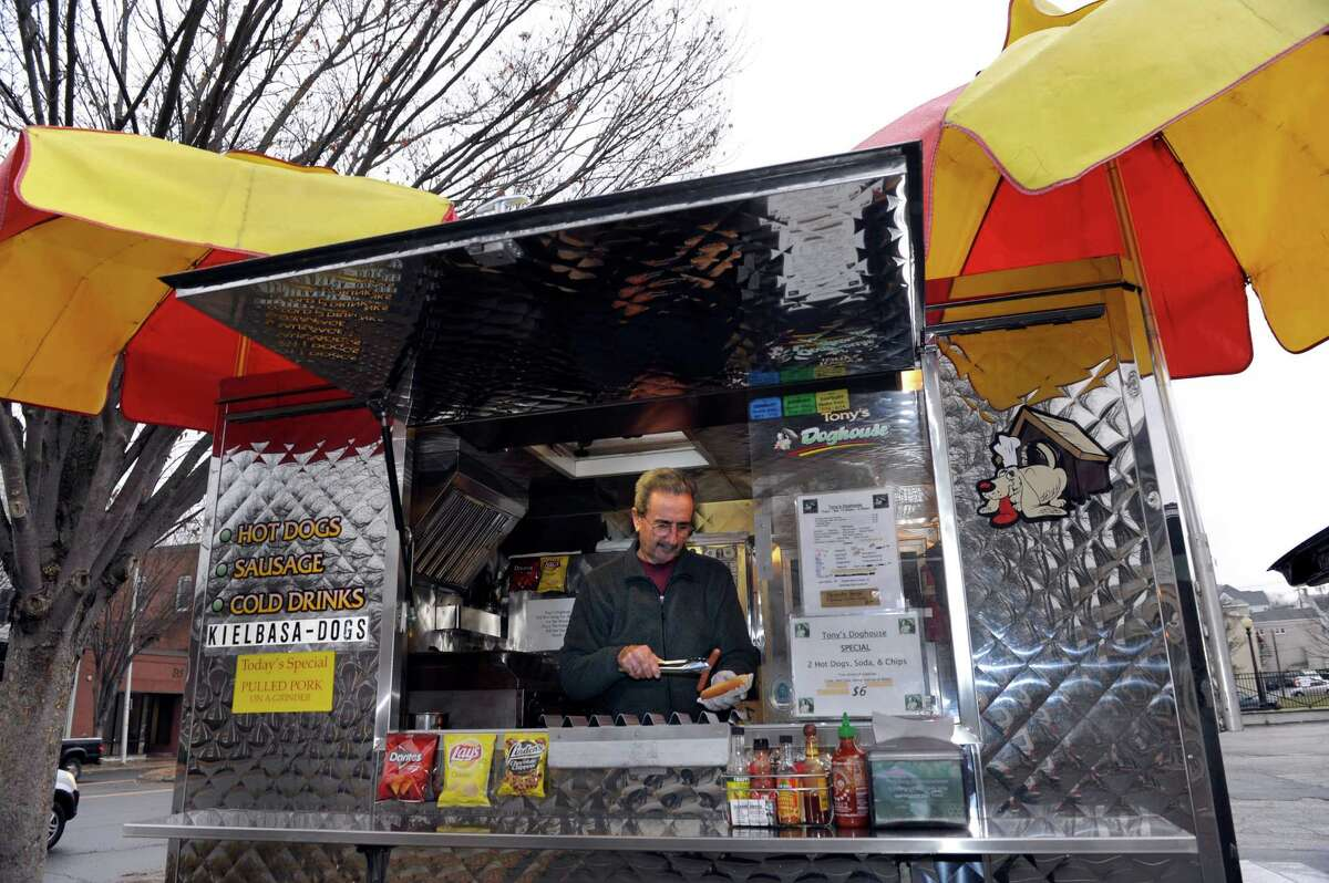 Tony Candullo, 70, of South Salem, N.Y., works his hot dog truck on Main Street in Danbury, Conn., Tuesday, Nov. 26, 2013. Tony's Doghouse is in its fourth year of business.