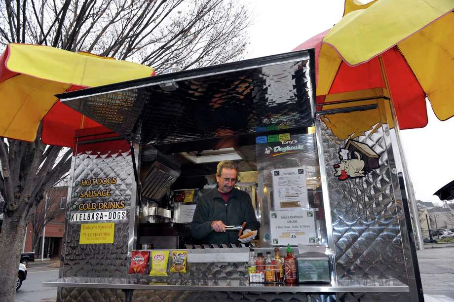 Tony Candullo, 70, of South Salem, N.Y., works his hot dog truck on Main Street in Danbury, Conn., Tuesday, Nov. 26, 2013. Tony's Doghouse is in its fourth year of business. Photo: Carol Kaliff / The News-Times