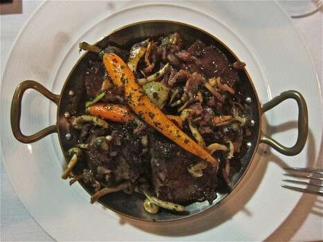 "Boeuf bourguignon (BOOF boor-gee-NYON): Hard to spell, much less pronounce, a classic French dish of beef braised in red wine and onions, and topped with sauteed mushrooms. Audio: Click here to hear the term ""Boeuf bourguignon."" Photo: Alison Cook"