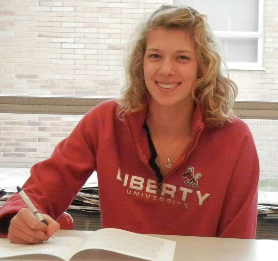 Fairfield Warde senior Chelsea Pond signs her national letter of intent to attend Liberty University next school year during a ceremony at the high school on Tuesday, Nov. 26. Photo: Reid L. Walmark / Fairfield Citizen