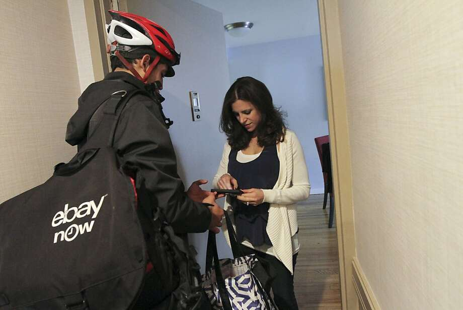 An eBay Now valet drops off a same-day delivery for a customer in New York. Photo: Tina Fineberg, New York Times
