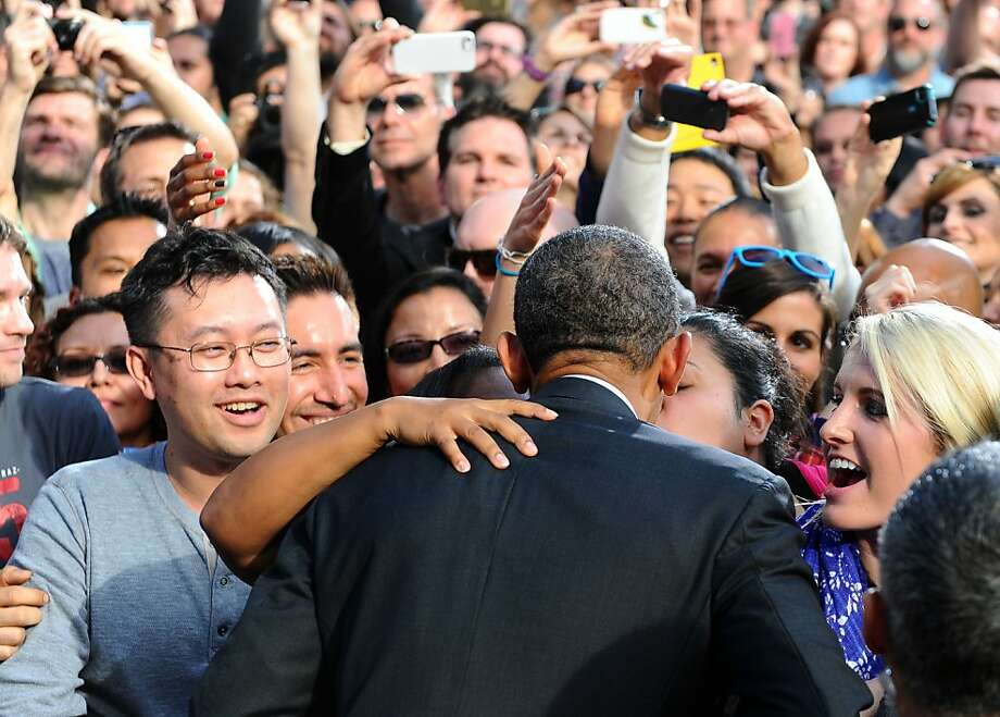 Thanks, but Michelle prefers that I just shake hands:After being heckled in San Francisco, President Obama gets a lot of lip from a supporter at DreamWorks Animation in Glendale, Calif. Photo: Jewel Samad, AFP/Getty Images