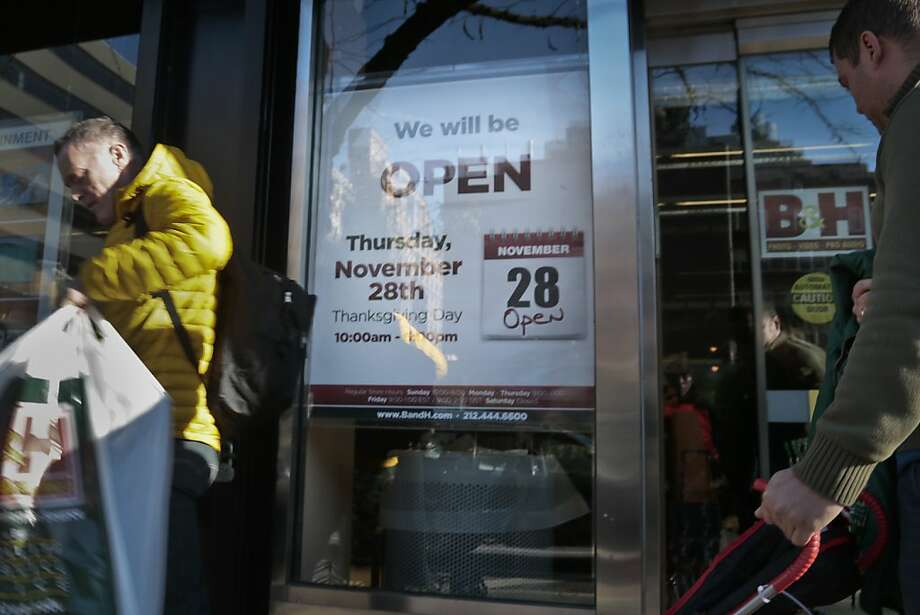 "A sign at a New York B&H electronics store reads ""We will be open"" on Thanksgiving Day. Several East Coast states bar stores from opening. Photo: Bebeto Matthews, Associated Press"
