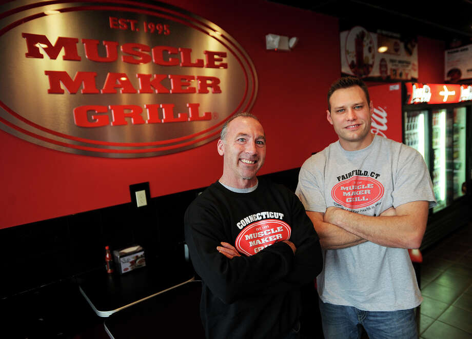 Craig Platt, left, of Trumbull, and Rob Painter, of The Bronx, NY, Connecticut franchisees for the Muscle Maker Grill, at their 2075 Black Rock Turnpike location in Fairfield, Conn. on Tuesday, November 26, 2013. Their second location just opened in Norwalk, with a third location slated to open in Hamden in February of next year. Photo: Brian A. Pounds / Connecticut Post