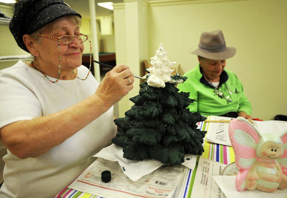 Linda Powers-Maloney, left, of Bridgeport, paints a pottery Christmas tree in the Ceramic Studio at the new Eisenhower Senior Center at 307 Golden Hill Streeet in Bridgeport, Conn. on Tuesday, November 26, 2013. Photo: Brian A. Pounds / Connecticut Post