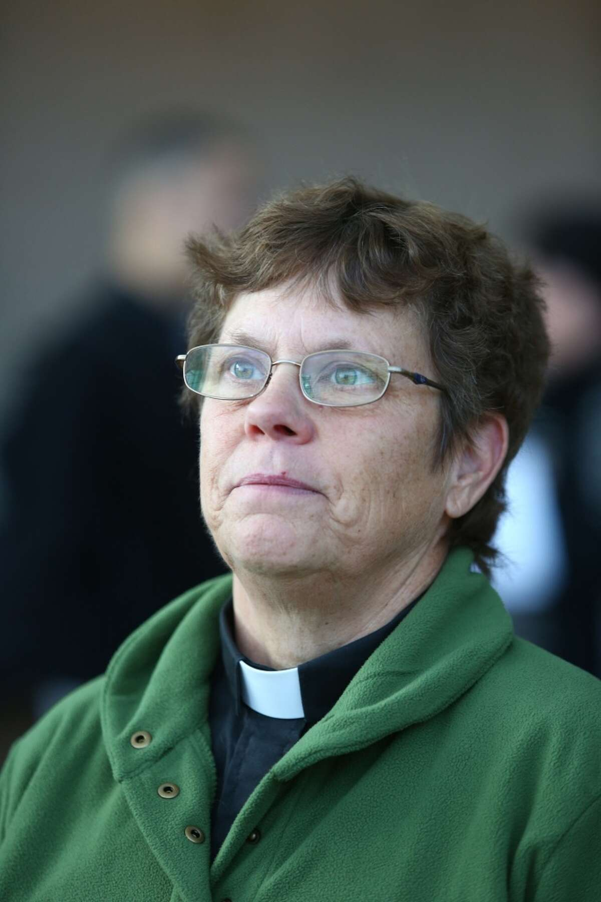 Rev. Jan Bolerjack of Riverton United Methodist Church in Tukwila joined supporters of SeaTac's Proposition 1, who gathered to declare victory on Tuesday, November 26, 2013 at Sea-Tac International Airport. The voter initiative will raise the minimum wage to $15 per hour.