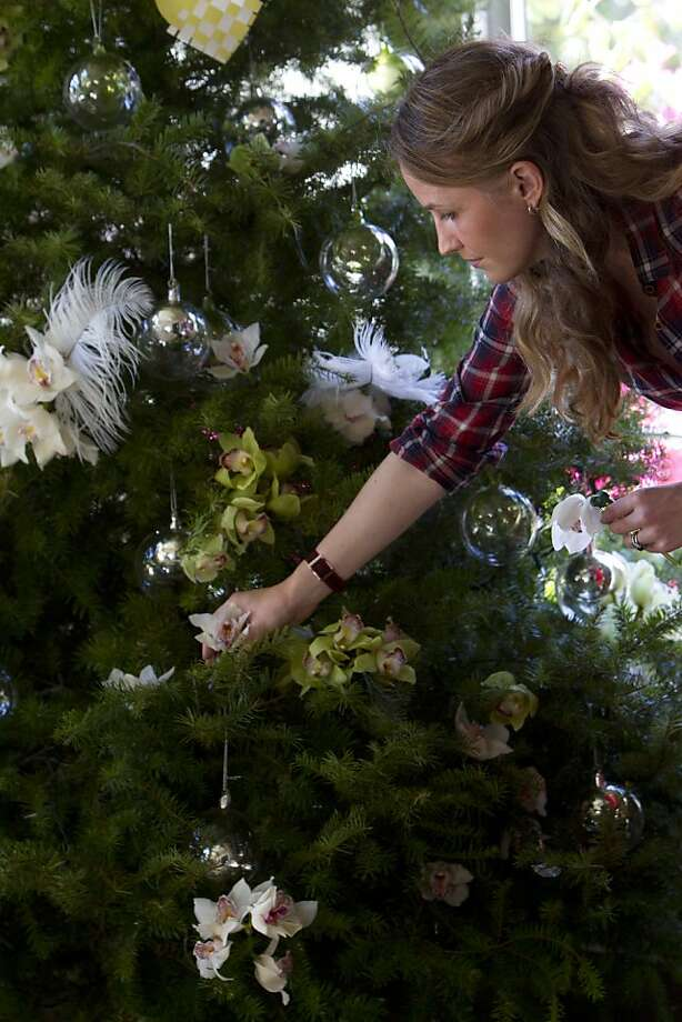 oakland designer chloe warner decorates her tree with fresh orchids feathers glass balls and