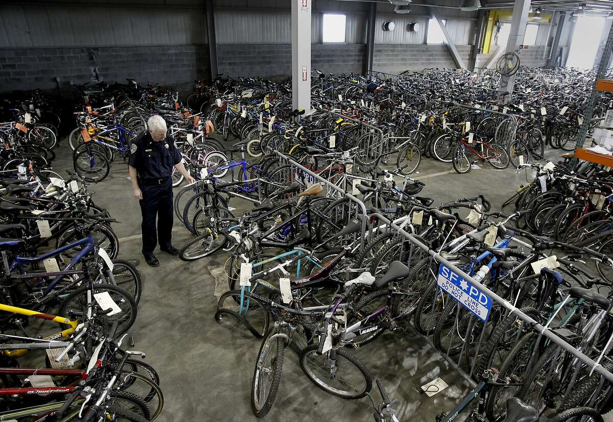 Above, Lt. Joe Cordes looks at an evidence tag on a bicycle at the police storage facility in Hunters Point.