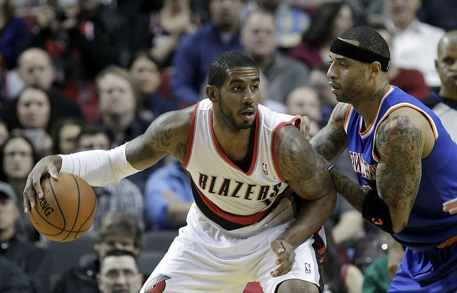 Portland Trail Blazers forward LaMarcus Aldridge, left, backs in on New York Knicks forward Kenyon Martin during the first half of an NBA basketball game in Portland, Ore., Monday, Nov. 25, 2013.(AP Photo/Don Ryan) Photo: Don Ryan, Associated Press