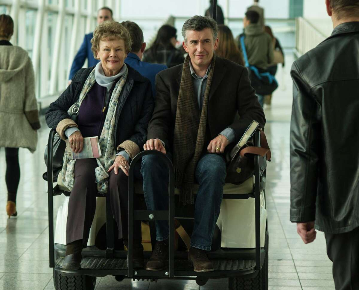 """This image released by The Weinstein Company shows Judi Dench, left, and Steve Coogan in a scene from """"Philomena."""" The British comic and Oscar-winning actress co-star in the film opening Friday, Nov. 22, 2013, which explores the benefits and costs of faith through the true story of Philomena Lee. (AP Photo/The Weinstein Company, Alex Bailey)"""