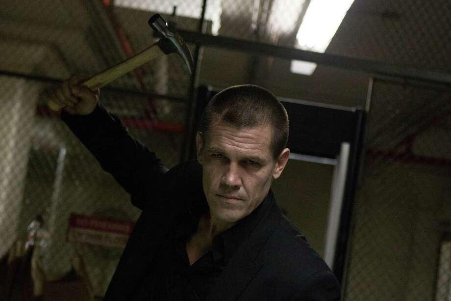 "Joe (Josh Brolin) seeks revenge on the people who held him captive for 20 years in ""Oldboy."" Photo: HANDOUT, HO / MCT"