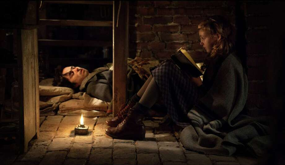 "This image released by 20th Century Fox shows Ben Schnetzer, left, and Sophie Nélisse in a scene from ""The Book Thief,"" about a girl who loves books. (AP Photo/20th Century Fox, Jules Heath) Photo: Jules Heath, HOEP / 20th Century Fox"