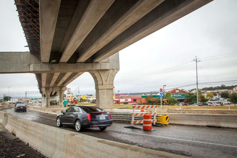 A bridge from Interstate 35 to The Forum shopping center crosses above a ramp linking Loop 1604 North to I-35 North. The Texas Department of Transportation announced the bridge will be opened the day before Thanksgiving, in time for holiday shopping at The Forum. Photo: Marc Arevalo, Courtesy Photo