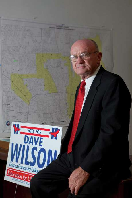 Dave Wilson, won elective office to the HCC Board of Trustees sits in front of a map of the Houston Community College district 2 and a campaign sign. Tuesday, Nov. 12, 2013, in Houston. ( Marie D. De Jesus / Houston Chronicle ) Photo: Marie D. De Jesus, Staff / © 2013 Houston Chronicle