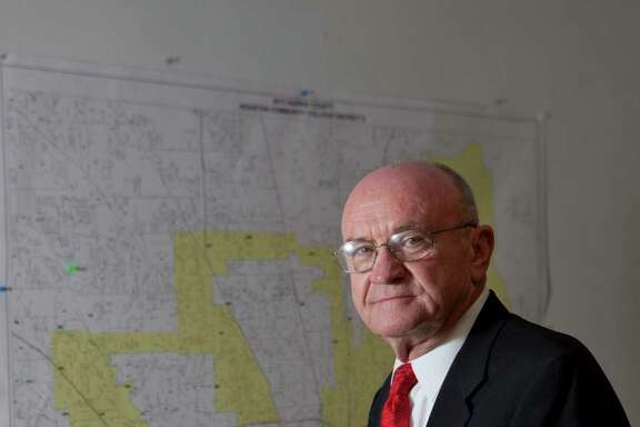 Dave Wilson, won elective office to the HCC Board of Trustees sits in front of a map of the Houston Community College district 2 and a campaign sign. Tuesday, Nov. 12, 2013, in Houston. ( Marie D. De Jesus / Houston Chronicle )