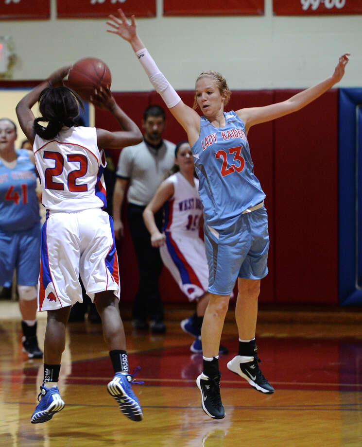 West Brook's Monii Jackson, No. 22, goes up for a shot while Lumberton's Megan Worry, No. 23, tries for a block during Tuesday's game. The Lumberton High School girls varsity basketball team played against West Brook at West Brook High School on Tuesday afternoon. Lumberton beat West Brook with a final score of 30-24. Photo taken Jake Daniels/@JakeD_in_SETX Photo: Jake Daniels / ©2013 The Beaumont Enterprise/Jake Daniels