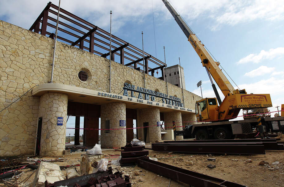 Renovations are ongoing at Alamo Stadium on Nov. 26, 2013. Among the major renovations are a newly built press box, scoreboard and field. Photo: Kin Man Hui, San Antonio Express-News / ©2013 San Antonio Express-News