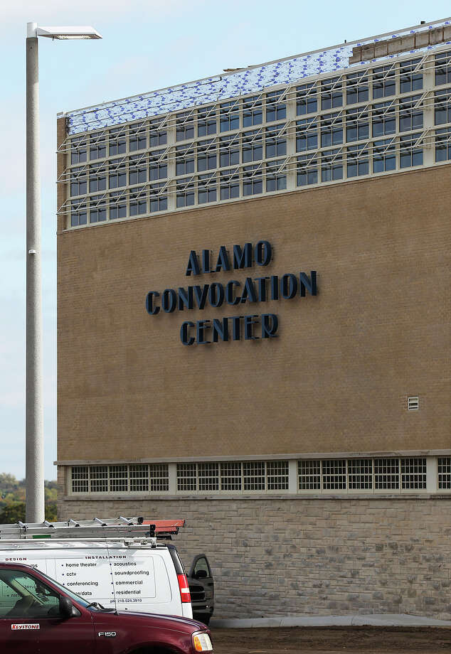 Restored exterior signage and window framing is seen at the Alamo Convocation Center as construction is still underway at the facility and at Alamo Stadium on Nov. 26, 2013. Photo: Kin Man Hui, San Antonio Express-News / ©2013 San Antonio Express-News