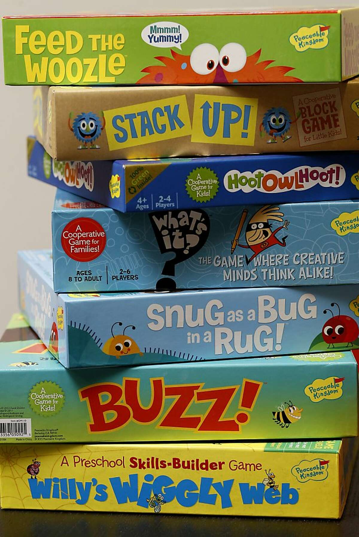 A selection of some board games offered by Peaceable Kingdom for Christmas in Berkeley, Calif. Peaceable Kingdom designs cooperative board games, cards and stickers for children from their offices in Berkeley, Calif.