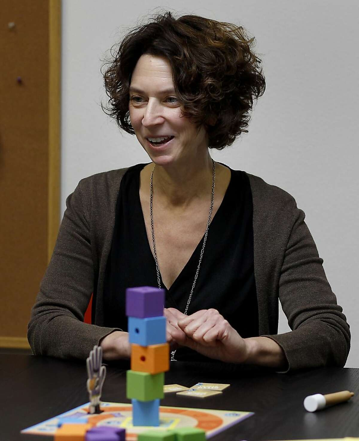 Peaceable Kingdom president Donna Jaffe smiles as she recalls the early days of her business Monday November 18, 2013 in Berkeley, Calif. Peaceable Kingdom designs board games, cards and stickers for children from their offices in Berkeley, Calif.