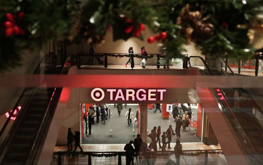 Holiday trimmings greet shoppers at a Target in New York. Consumers this season might be weighing their purchases against wages that have remained flat. Photo: Bebeto Matthews / Associated Press