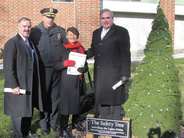 The Safety Tree, a community symbol honoring those killed in drunken driving-related crashes, was re-dedicated in a ceremony at Ellis Hospital on Monday. The tree is draped in white lights. If there is a drunked driving-related death in Schenectady County, a white light is removed and replaced with a red light. Shown are Ellis Medicine President & CEO James W. Connolly; Police Chief Brian Kilcullen; Doris Aiken, national founder of Remove Intoxicated Drivers, and Mayor Gary McCarthy. (Provided photo)