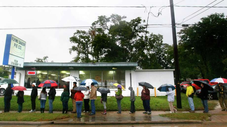 Customers wait outside Tuesday to buy pies from Flying Saucer Pie Co., which expects to sell thousands of the pies this week. Photo: Cody Duty, Staff / © 2013 Houston Chronicle