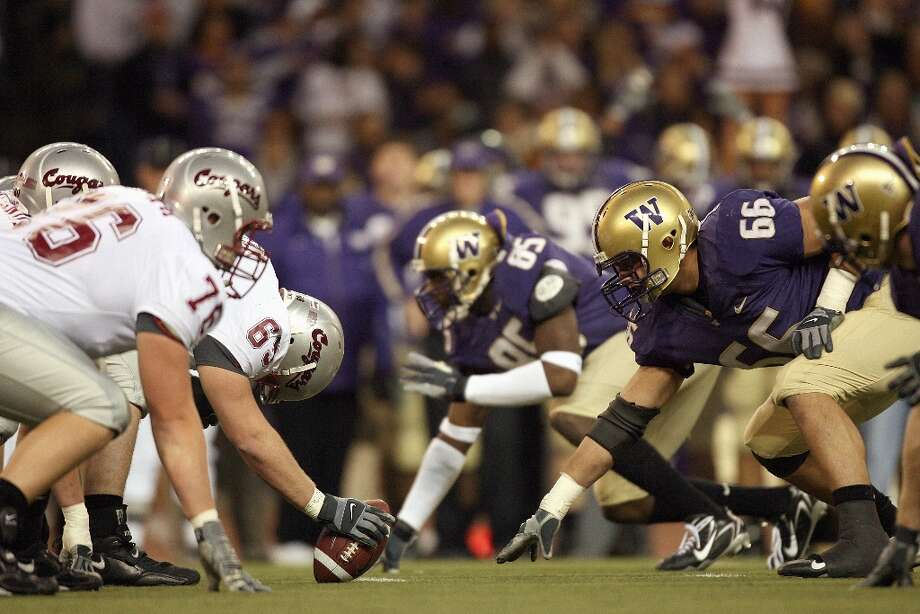 The No. 5 Washington Huskies and No. 23 Washington State Cougars meet in a high-stakes Apple Cup matchup on Friday. Photo: Otto Greule Jr, Getty Images / 2007 Getty Images