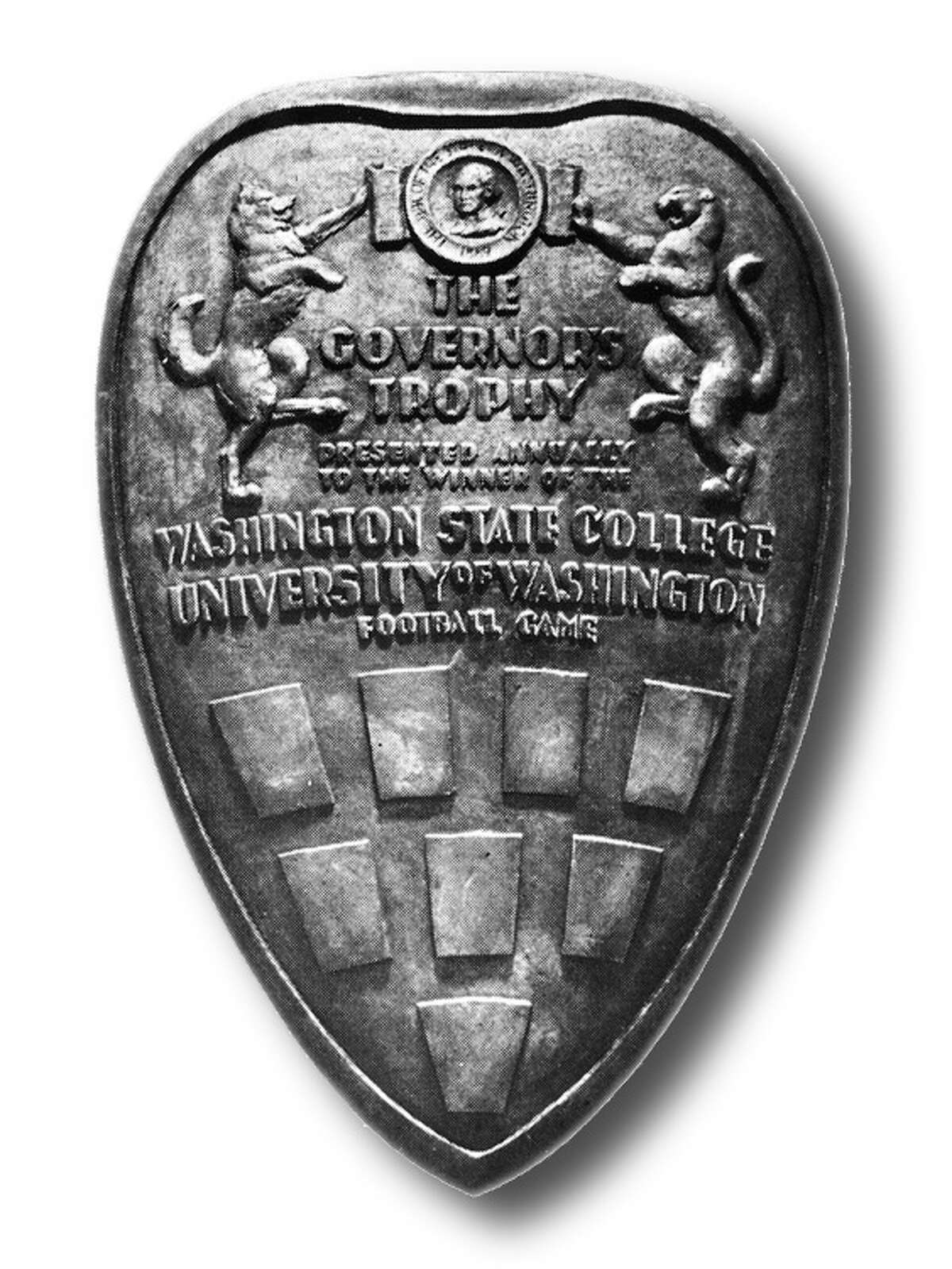 The Governor's TrophyThe rivalry wasn't officially called the Apple Cup until 1962. Before then, the winning team was given the Governor's Trophy, pictured above, instead of the Apple Cup. From 1959 through 1966, the Huskies had their first eight-game winning streak in the series, eventually to be followed by another eight-game streak from 1974 through 1981 and a six-game streak from 1998 through 2003. The Cougars have never won more than two Apple Cups in a row, most recently achieving the feat in 2007 and 2008.