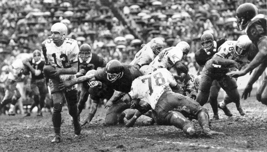 1968: Washington State 24, Washington 0In 1968, the Cougars won their second Apple Cup game in a row in lopsided fashion, as WSU quarterback Hank Grenda (pictured, No. 12) rushed for one touchdown, passed for two more, and kicked three PATs and a field goal in Spokane. But the Huskies surged back to win the next three Apple Cups with legendary quarterback Sonny Sixkiller under center. By the end of the 1960s, the Huskies led the all-time series 38-18-6. Photo: ????, Seattle P-I Archives