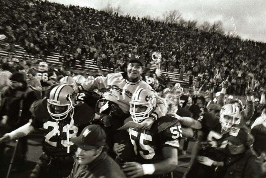 "1982: Washington State 24, Washington 20Among Wazzu fans, the 1982 Apple Cup is known as the ""Revenge of the Roses."" It featured the 2-7-1 Cougars facing the fifth-ranked and 9-1 Huskies, who obviously were heavily favored to win. But WSU shocked UW in the series' first return to Pullman since 1954, after nearly three decades of splitting the rivalry at Spokane's Joe Albi Stadium. Seeking vengeance of the year before, the Cougars took their home field dressed in all crimson. When Wazzu prevailed 24-20, fans rushed the field, head coach Jim Walden was carried off on his players' shoulders (pictured), and students tore down the Martin Stadium goal posts then threw them in the Palouse River. Photo: Washington State University Archives"