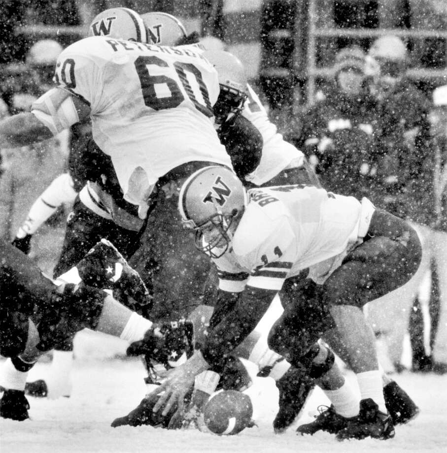 "1992: Washington State 42, Washington 23Known these days as the ""Snow Bowl,"" the 1992 Apple Cup was a disaster for defending national champion Washington. Future Pro Bowl quarterback Brunell couldn't hold onto the ball in the biting Pullman cold, as evidenced by the fumble pictured above, and ended up passing just 11-of-26 for 122 yards, albeit with two rushing touchdowns. Meanwhile, future Pro Bowl quarterback Drew Bledsoe of the Cougars threw for 259 yards and two TDs. After trailing 7-6 at halftime, WSU put up 29 points in the third quarter against the No. 5 Dawgs as the wind chill hit minus-18 degrees. ""It was the most fun I've ever had in the snow,"" Cougars coach Mike Price said later. Wazzu jumped back into the rankings after that Apple Cup and, as the No. 18-ranked team, beat Utah 31-28 in the Copper Bowl. Washington ended up losing 38-31 to No. 7 Michigan in the Rose Bowl. Photo: P-I FILE/1992, Seattle P-I Archives"