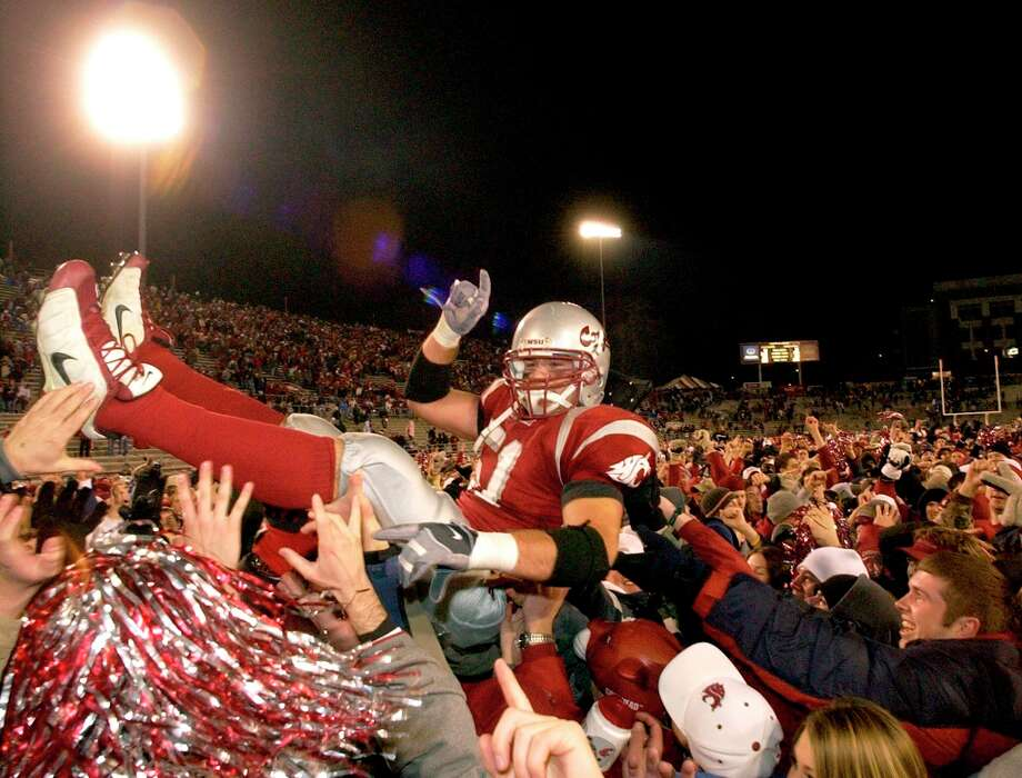 "2004: Washington State 28, Washington 25The Huskies, embroiled in an athletic department scandal, entered Martin Stadium with a dismal 1-9 record but a chance to take down the Cougars in the ever-unpredictable Apple Cup. They nearly did as backup quarterback Isaiah Stanback, a freshman, replaced starter Casey Paus and provided a much-needed spark for the Huskies. WSU fans in the stands could smell another ""Coug'd"" Apple Cup, but the Wazzu defense came through and held the Huskies off for the Cougars' first rivalry win since 1997. WSU quarterback Alex Brink threw two touchdowns and linebacker Will Derting (pictured) scored a touchdown on a fumble forced by linebacker Scott Davis. The Cougs finished that season 5-6 in the first year of a downward spiral. Photo: Rajah Bose, Associated Press / AP"
