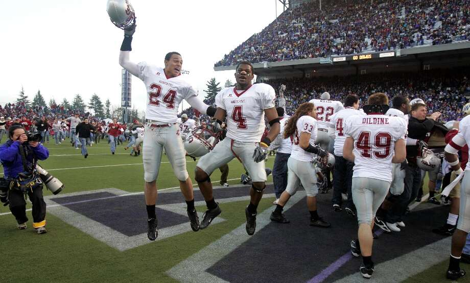 "2005: Washington State 26, Washington 22Brink threw for 283 yards and two touchdowns, and running back Jerome Harrison -- the nation's leading rusher -- ran for 207 yards and a TD, as the Cougars came into Husky Stadium and captured their second-straight Apple Cup in 2005. The winning score came with just 1:20 remaining, when Brink tossed a short pass to wide receiver Trandon Harvey, who ran the remaining 39 yards to the end zone. After the game, Washington State's Christian Bass (pictured, No. 24) and Omowale Dada (No. 4) danced on Husky Stadium's midfield ""W"" logo, causing some of the Huskies players to rush back from the sidelines and confront them. A shoving match commenced among about 100 players. Photo: Elaine Thompson, Associated Press / AP"
