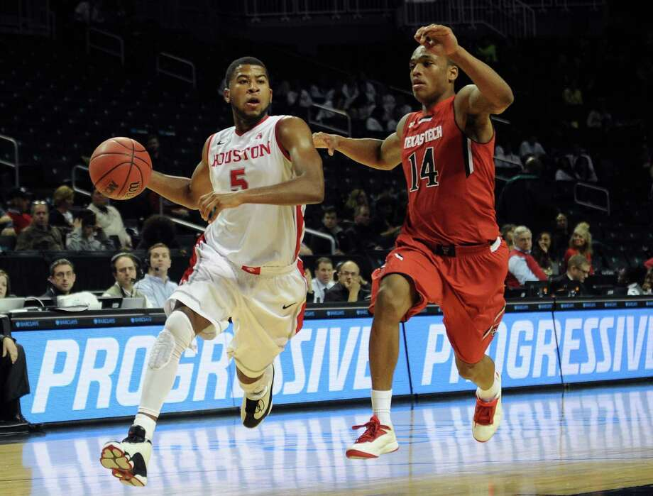 NEW YORK, NY - NOVEMBER 26: L.J. Rose #5 of the Houston Cougars drives past Robert Turner #14 of the Texas Tech Red Raiders during the second half at Barclays Center on November 26, 2013 in the Brooklyn borough of New York City. Photo: Maddie Meyer, Getty Images / 2013 Getty Images