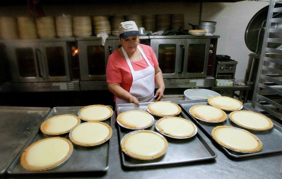 Lilia Medellin prepares pies at Flying Saucer Pie Co., Tuesday, Nov. 26, 2013, in Houston. To prepare for the demand, the company started baking Monday night. They expect to sell thousands of pies this week. Photo: Cody Duty, Houston Chronicle / © 2013 Houston Chronicle