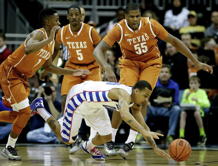 DePaul's Brandon Young, front and Texas' Isaiah Taylor (1), Damarcus Croaker (5) and Cameron Ridley (55) chase a loose ball during the first half of an NCAA college basketball game Tuesday, Nov. 26, 2013, in Kansas City, Mo. (AP Photo/Charlie Riedel) Photo: Charlie Riedel, Associated Press / AP