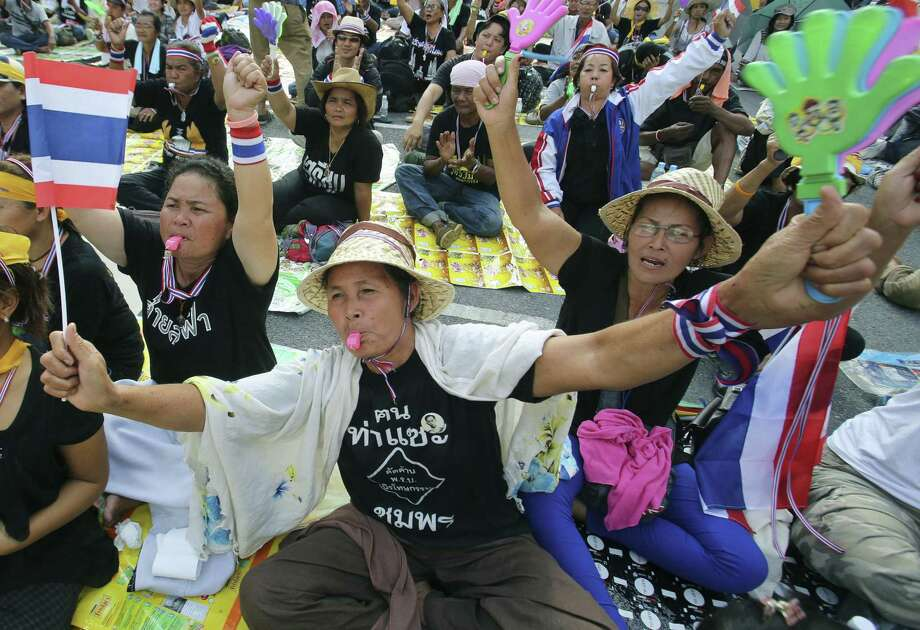 Anti-government demonstrators stage a sit-in at Thailand's Finance Ministry in Bangkok. Their leader says their goal is to topple the government. Photo: Sakchai Lalit / Associated Press