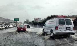 Southbound Highway 101 in San Francisco, near Paul Avenue, flooded during last week's rainstorm, as witnessed in this photo shot from a car. Traffic was reduced to one or two lanes, depending on how deep drivers were willing to submerge their vehicles.