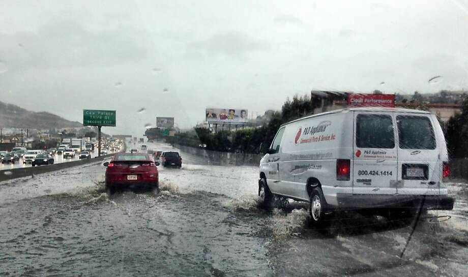 Southbound Highway 101 in San Francisco, near Paul Avenue, flooded during last week's rainstorm, as witnessed in this photo shot from a car. Traffic was reduced to one or two lanes, depending on how deep drivers were willing to submerge their vehicles. Photo: Kurtis Alexander