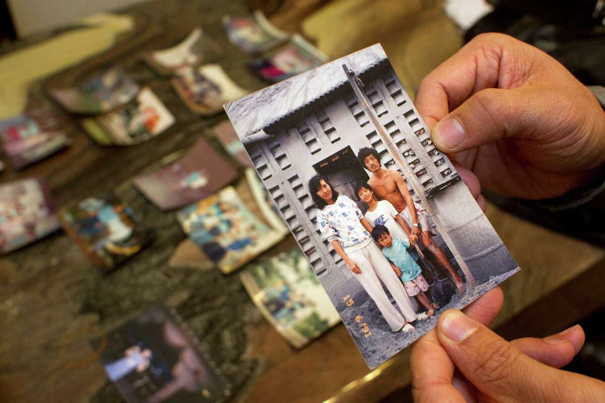 Alex Tang, now 34 and living in Houston, treasures a picture of his father, Nam Duong, mother, Mai Ly, younger brother, Hung Tang, 2, and himself at age 9 in a Philippines refugee camp after the Vietnam War.